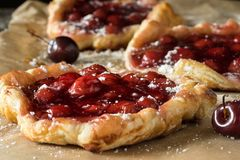 Making cherry pies Stock Image