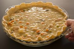 Making chicken pot pie Royalty Free Stock Images