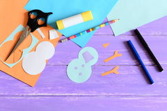 Making a children winter paper card. Step. Snowman parts cut from paper, scissors, markers, pencil, glue stick, colored paper set Stock Photos