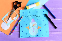 Making a children winter paper cards. Step. Paper card with snowman collage and text I love winter. Stationery and materials Royalty Free Stock Photo