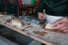 Making Chinese writing brush. Es by hand in Huzhou stock images