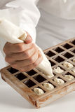 Making chocolates Royalty Free Stock Photo
