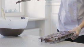 Making chocolates candies stock video
