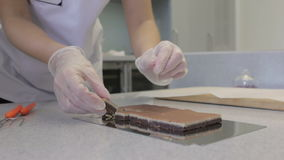 Making chocolates candies stock video footage