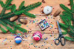 Making Christmas ball pinning the sequins onto the ball Stock Photography