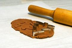 Making christmas cookies. Making christmas gingerbread cookies: cutting christmas tree Stock Photo