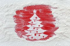 Making christmas cookies concept - xmas tree drawing in flour on stock photography