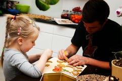Making Christmas cookies Royalty Free Stock Image