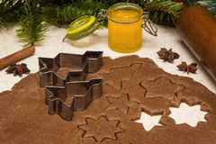 Making christmas gingerbread cookies with honey and cinnamon. stock photo