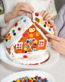 Making Christmas Gingerbread House Together Royalty Free Stock Image