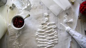 Making Christmas sweet meringues with pomegranate stock video footage