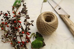 Making a Christmas wreath. Making a garland for the winter holidays Royalty Free Stock Images