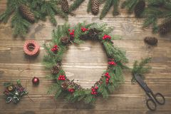 Making Christmas wreath using fresh and all natural materials. Flat lay. Top view. royalty free stock photography