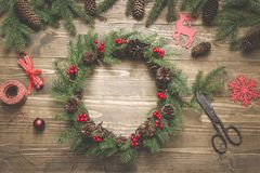 Making Christmas wreath using fresh and all natural materials. Flat lay. Top view. Space for text royalty free stock image