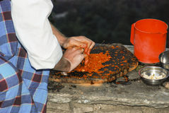 Making chutney with stone grinder. A man making chutney with a stone grinder Stock Photography