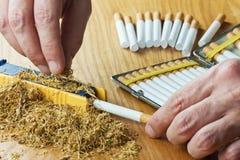Making cigarettes Stock Photo