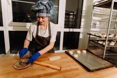Making cinnamon buns. Homemade raw yeast dough after raising ready to bake Royalty Free Stock Photos