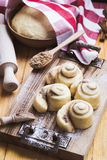 Making cinnamon buns. Homemade yeast dough after raising Royalty Free Stock Photography