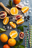 Making citrus smoothies and drinks. Ingredients for summer citrus smoothies and drinks royalty free stock images