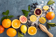 Making citrus smoothies and drinks. Ingredients for summer citrus smoothies and drinks stock images
