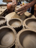 Making clay pot Stock Images