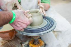 Making a clay pot stock photography