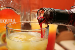 Making a cocktail. (Tequila Sunrise Royalty Free Stock Photo