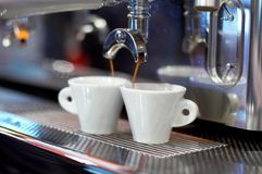 Making coffee. Two coffee cups on The coffee device/machine Stock Photography