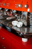 Making coffee #3. Two coffee cups on The coffee device/machine (#3 Royalty Free Stock Photography