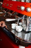 Making coffee #4. Two coffee cups on The coffee device/machine (#3 Royalty Free Stock Photos
