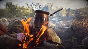 Making coffee with bonfire in the woods stock footage