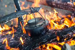 Making coffee on camp fire Royalty Free Stock Images