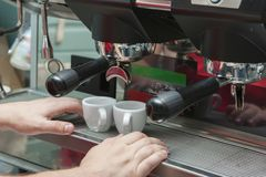 Making coffee Coffee machine, barman`s hands royalty free stock photo