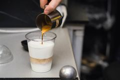 Making coffee in a coffee shop. royalty free stock images
