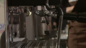 Making coffee in electric coffe machine in a cafe stock footage