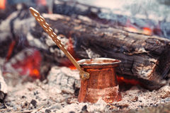 Making coffee in the fireplace  on camping or hiking in the natu Royalty Free Stock Images