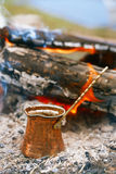 Making coffee in the fireplace  on camping or hiking in the natu Stock Photos