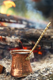 Making coffee in the fireplace  on camping or hiking Royalty Free Stock Image