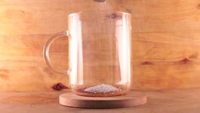 Making coffee. Making instant coffee with sugar in clear cup stock video footage