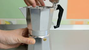 Making coffee in a moka pot stock footage