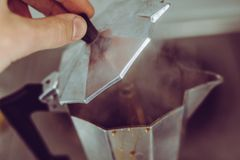 Steamy coffee percolator making coffee for daily cafeine espresso Royalty Free Stock Image