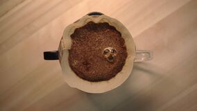 Making coffee with pour over method in the morning