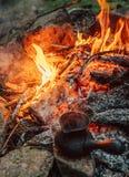 Making coffee process on campfire. Turkish cezva near open fire Stock Photography