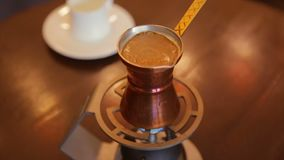 Making coffee in a Turkish. Making Turkish coffee indoors,full hd video stock video