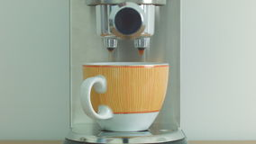 Making coffee using the coffee machine in a orange cup. Men's hand making espresso coffee using coffee machines stock video footage