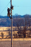 Making a connection. Lineman making an electrical hookup in rural setting stock images
