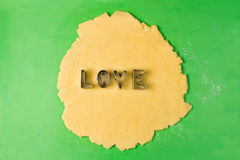 Making cookie letters with cutters Stock Photos