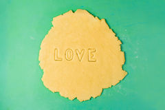 Making cookie letters with cutters Royalty Free Stock Images