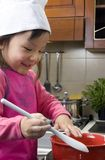 Making Cookies 007. Two young sisters have fun in the kitchen making a mess....I mean making cookies. Education, learning, cooking, childhood Royalty Free Stock Photography