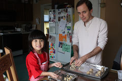 Daughter and dad make cookies Royalty Free Stock Image